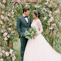 Classic bride and groom portrait with flower arbor Barn Wedding - Twah Photography