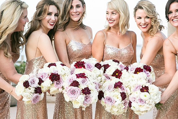 Fun rose gold sequin wedding dresses and bridesmaids bouquets with white and burgundy A Glamorous Wedding with Fireworks - Rachael Hall Photography