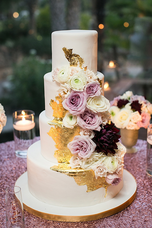 Glam gold and white wedding cake with flowers A Glamorous Wedding with Fireworks - Rachael Hall Photography
