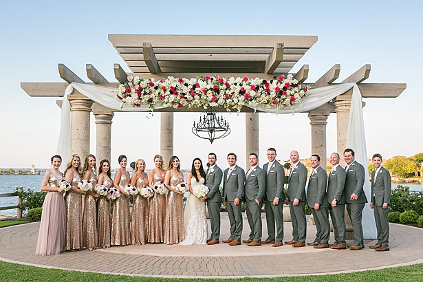 Glittery rose gold bridesmaids dresses and grey groom suit bridal party photo A Glamorous Wedding with Fireworks - Rachael Hall Photography