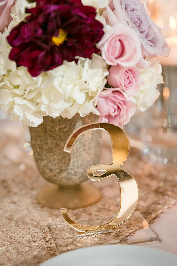 Gold table number for reception A Glamorous Wedding with Fireworks - Rachael Hall Photography