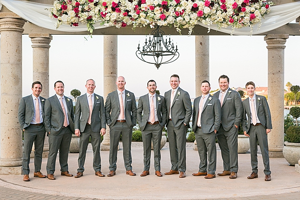 Grey groomsmen suits with pink ties A Glamorous Wedding with Fireworks - Rachael Hall Photography