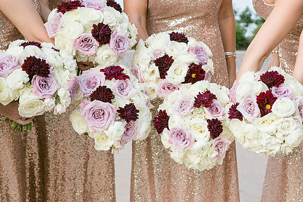 Luxe bridesmaids bouquets with white, burgundy and purple flowers and gold sequin bridesmaids dresses A Glamorous Wedding with Fireworks - Rachael Hall Photography