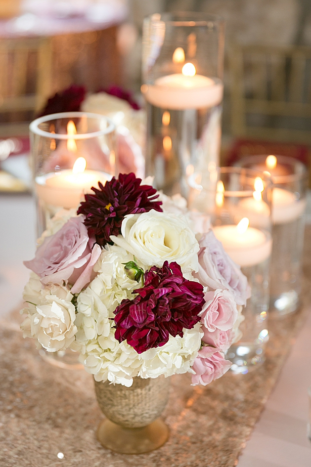 Romantic candle and flower reception centerpiece A Glamorous Wedding with Fireworks - Rachael Hall Photography