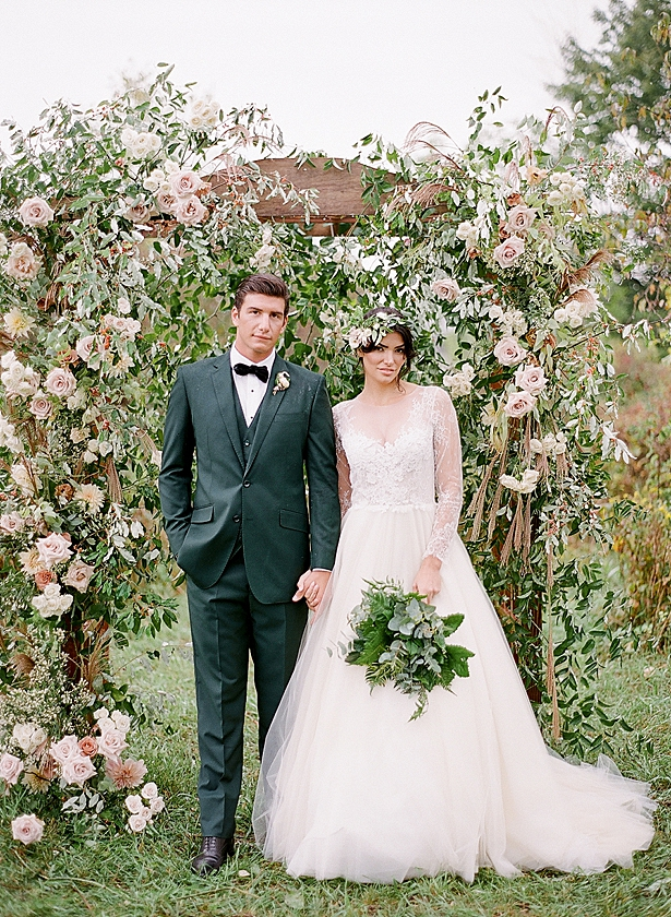 Romantic ceremony arbor with flowers and bride and groom Barn Wedding - Twah Photography