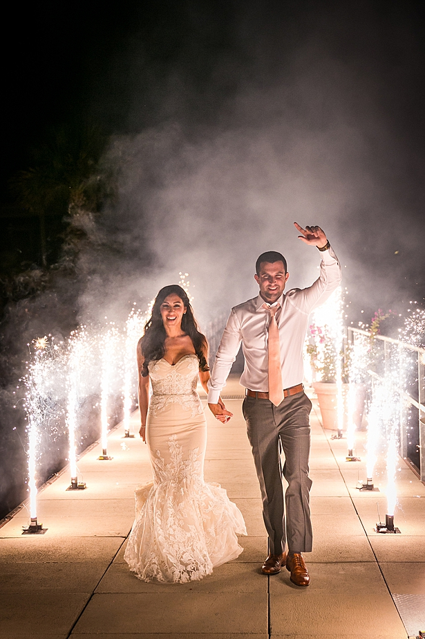 Romantic wedding exit with bride and groom A Glamorous Wedding with Fireworks - Rachael Hall Photography