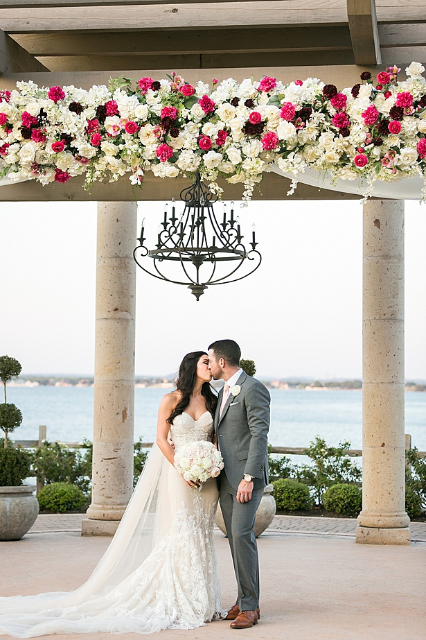 Romantic photo of couple kissing under wedding pergola A Glamorous Wedding with Fireworks - Rachael Hall Photography