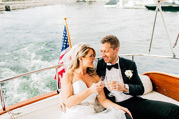 Bride and groom toasting on a boat - Jenna Bacholt Photography