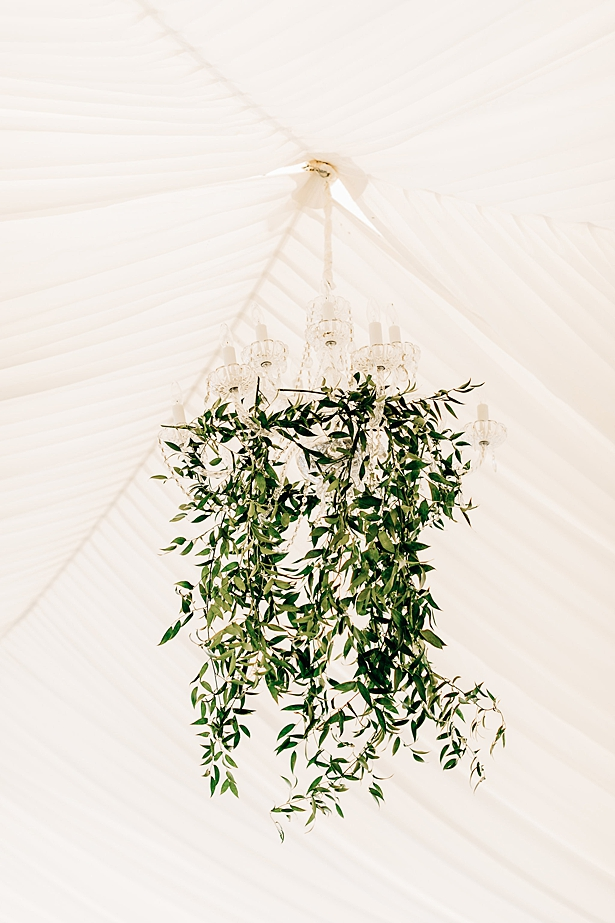 Elegant tented wedding with hanging chandelier with greenery - Jenna Bacholt Photography