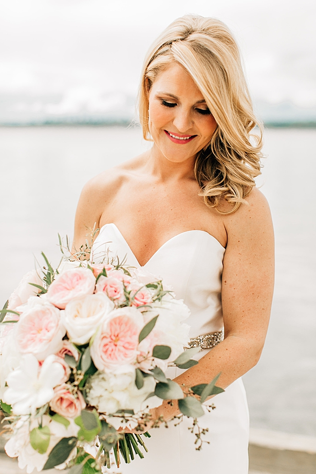 Glam bridal makeup photo of bride with strappless white sating wedding dress - Jenna Bacholt Photography