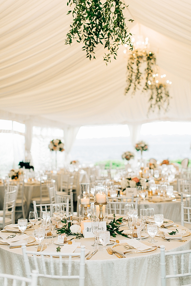 Gold reception decor with candles and greenery for a tented wedding reception - Jenna Bacholt Photography