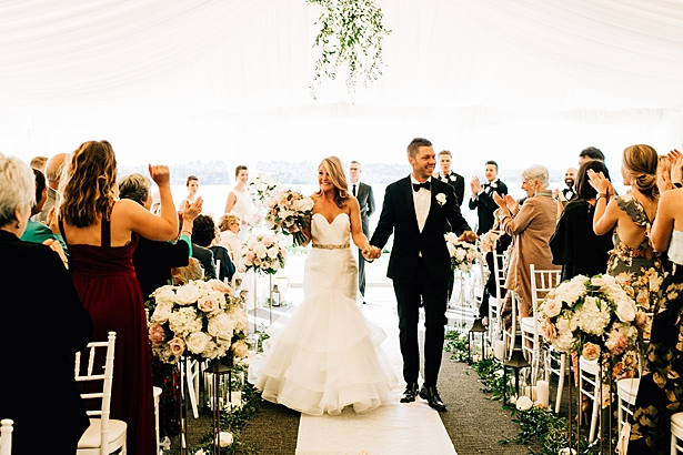 elegant tented wedding with bride and groom exiting - Jenna Bacholt Photography