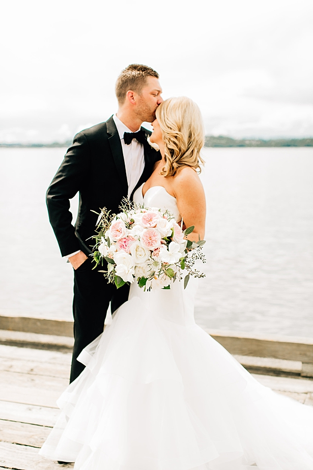 elegant wedding photo of bride and groom by the water - Jenna Bacholt Photography