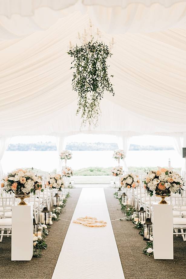 elegant wedding tent with hanging florals and white draping - Jenna Bacholt Photography