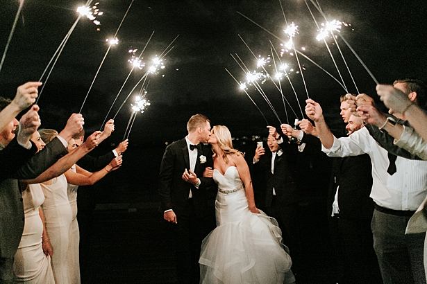romantic photo of bride and groom during their sparkler exit - Jenna Bacholt Photography