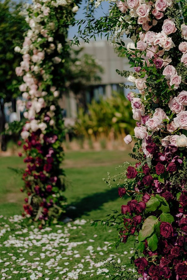 Blush and burgundy wedding floral arch - Madiow Photography