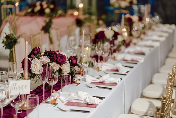 Blush gold and burgundy wedding reception table settings - Madiow Photography