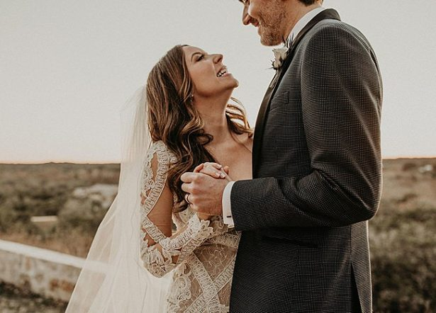 Boho Glamorous Wedding fun photo of bride and groom at sunset - Nikk Nguyen Photo