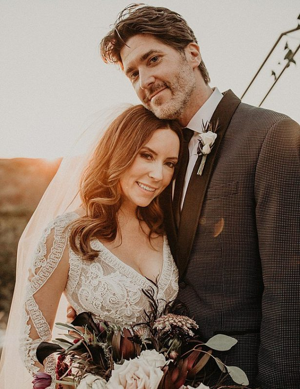 Boho Glamorous Wedding romantic sunset photo of bride and groom - Nikk Nguyen Photo