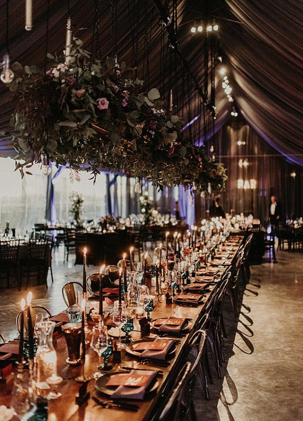 Boho Glamorous Wedding seated dinner reception setup with hanging florals