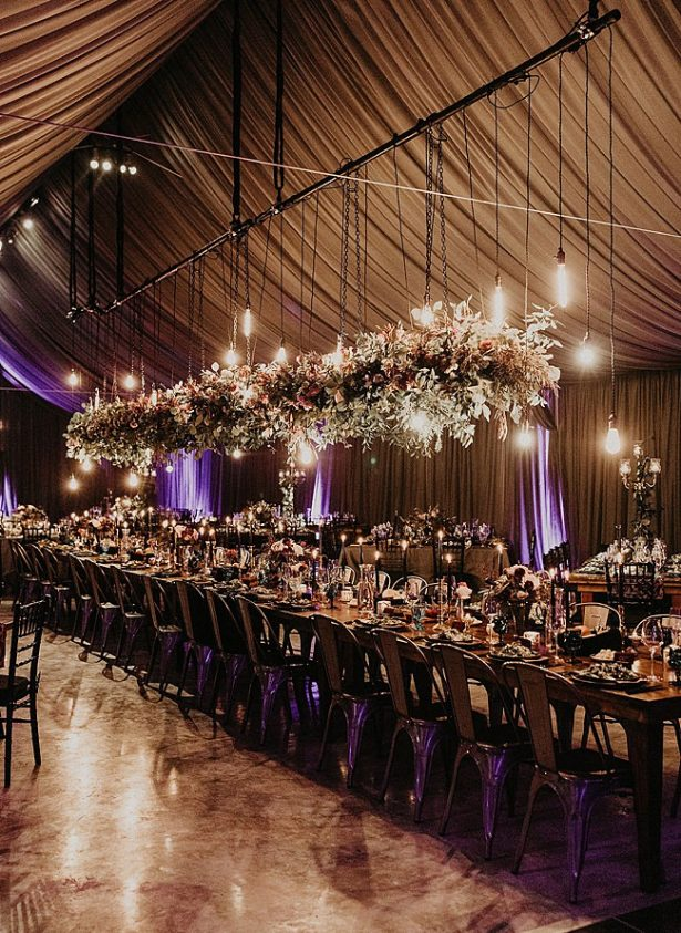 Boho Glamorous Wedding wedding reception with hanging flowers and family style seated dinner - Nikk Nguyen Photo