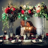 Bold black and red wedding reception decor with bride and groom - Little Honey Photography