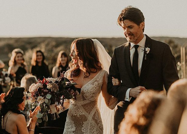 Bride in boho glamorous wedding dress and groom in classic black tux - Nikk Nguyen Photo