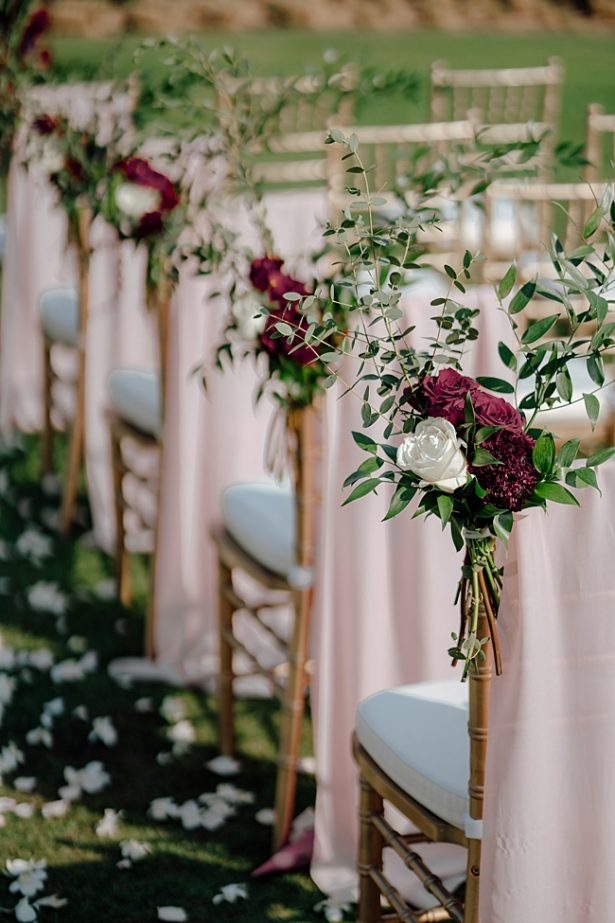 Burgundy wedding chair markers with gold chairs - Madiow Photography