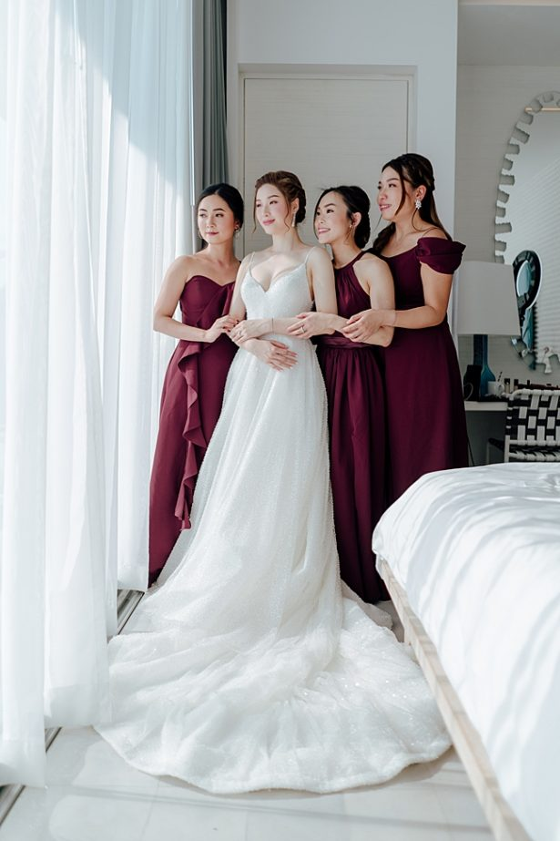 Classy photo of bride with bridesmaids - Madiow Photography