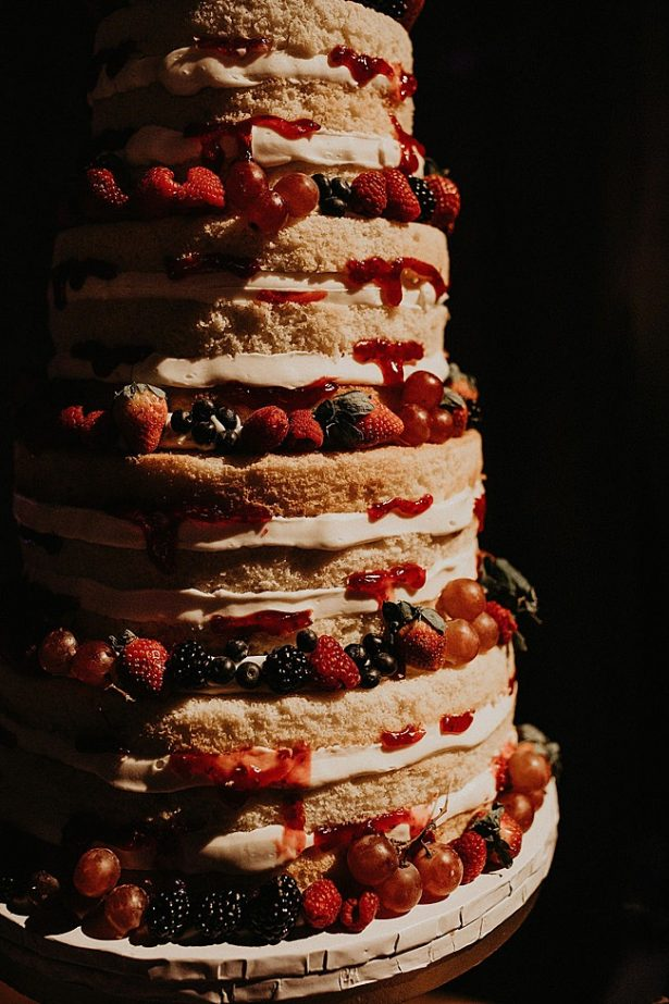 Delicious naked wedding cake with berries - Nikk Nguyen Photo