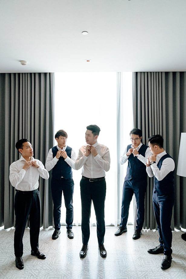 Epic groom getting ready shot with groomsmen - Madiow Photography