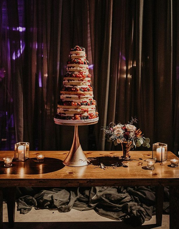 Multi-tiered naked wedding cake with berries - Nikk Nguyen Photo