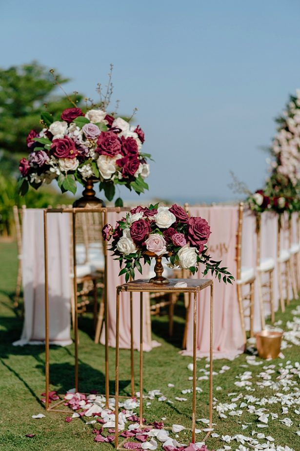 Romantic blush and burgundy wedding ceremony floral arrangements - Madiow Photography