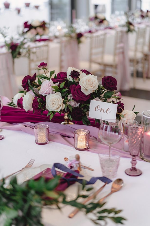 Romantic blush and burgundy wedding reception decor - Madiow Photography