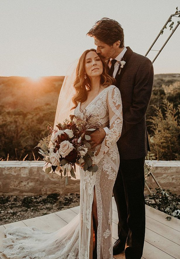 Romantic sunset photo of bride and groom - Nikk Nguyen Photo