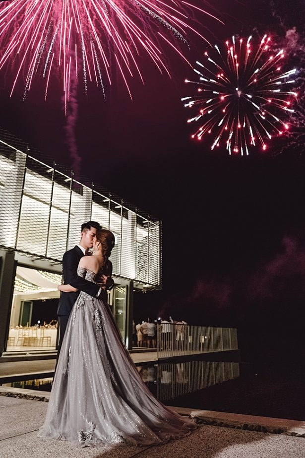Wedding firework photo with bride and groom - Madiow Photography