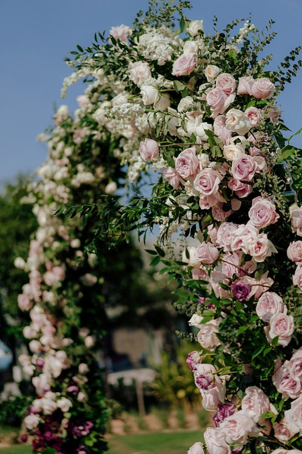 blush and white ceremony arbor for outdoor ceremony - Madiow Photography