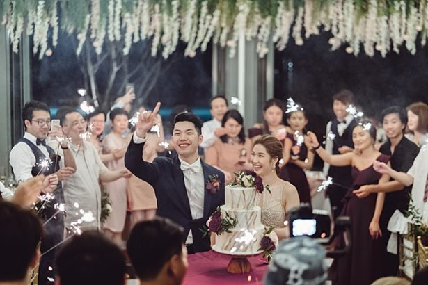 shot of bride and groom at reception with sparklers - Madiow Photography
