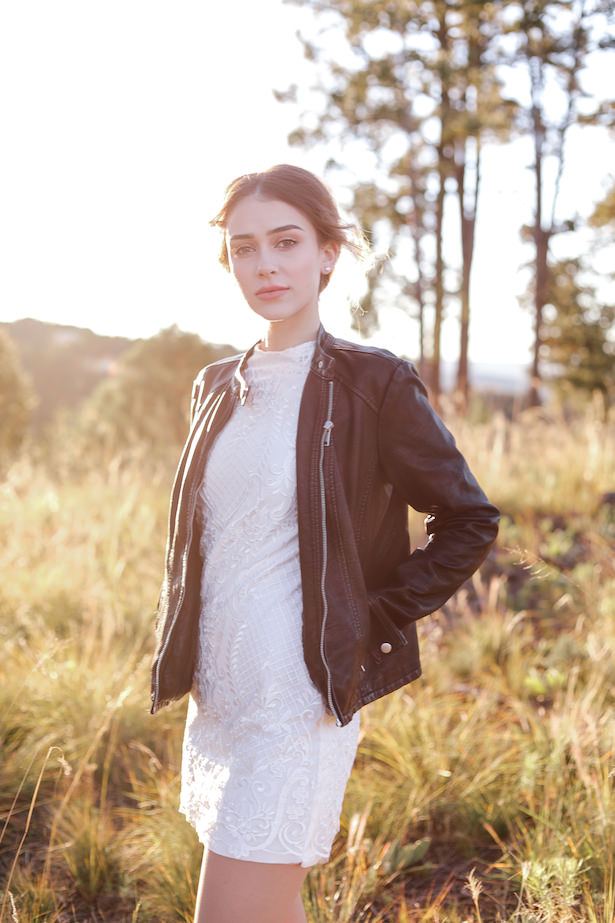 Edgy bridal look with short lace wedding dress and black leather jacket - Photo: Tiffany Hudson Films