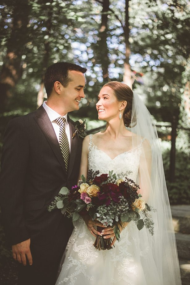 Elegant Fall Wedding photo of bride and groom with burgundy wedding flowers - Aileen Elizabeth Photography