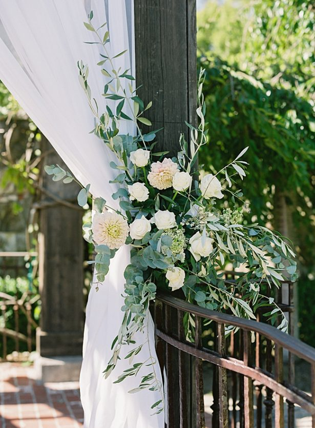 Gorgeous wedding ceremony arbor decor with white flowers and greenery - O'Malley Photography
