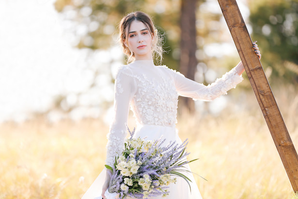 House of Maganda wedding ceremony with bride in long sleeve floral wedding dress - Photo: Tiffany Hudson Films