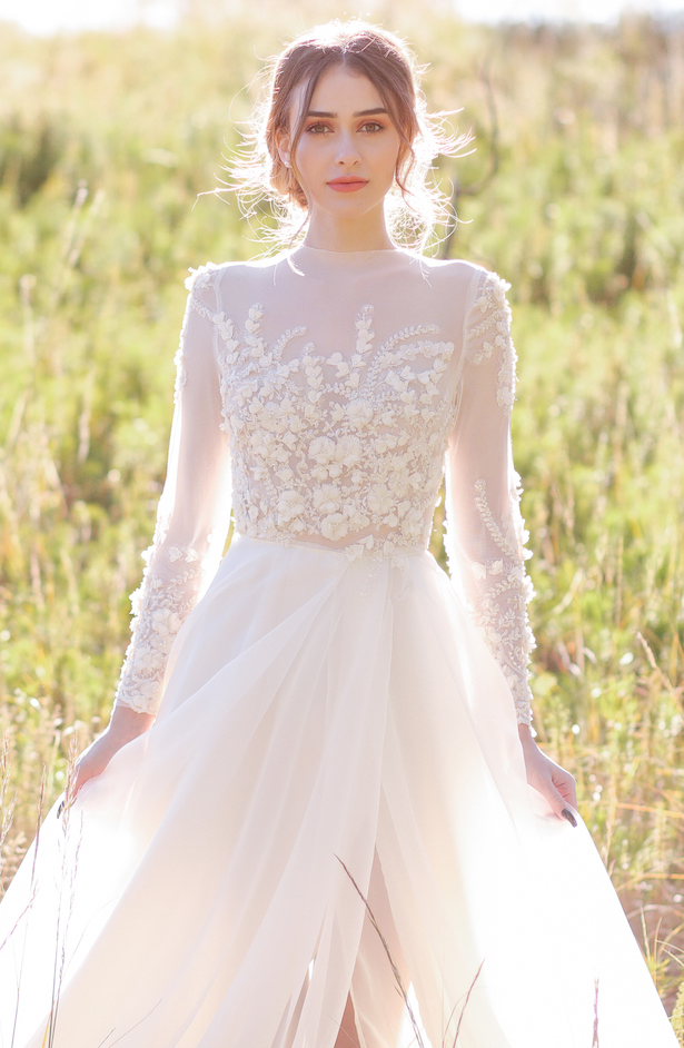 Modest A-line wedding dress with long sleeves - Photo: Tiffany Hudson Films