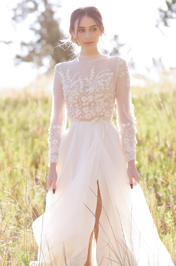 A-line wedding dress with long sleeves - Photo: Tiffany Hudson Films