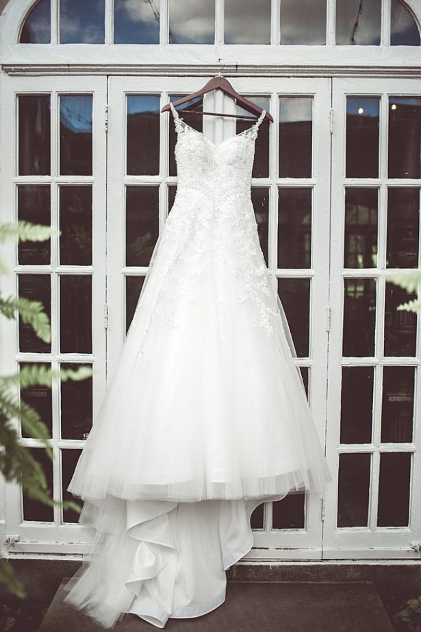 Lace and tulle wedding dress hanging - Aileen Elizabeth Photography