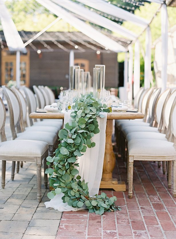 Napa Wedding reception table decor with overflowing greenery- O'Malley Photography