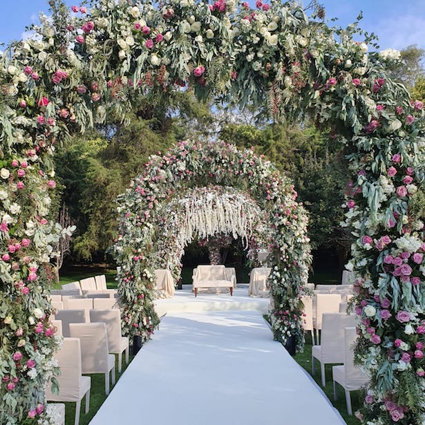 Opulent Luxury Wedding Ceremony with floral arches - Photography: Vincent Zasil