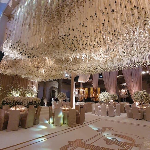 Opulent Luxury Wedding reception decor with hanging flowers - Photography: Vincent Zasil