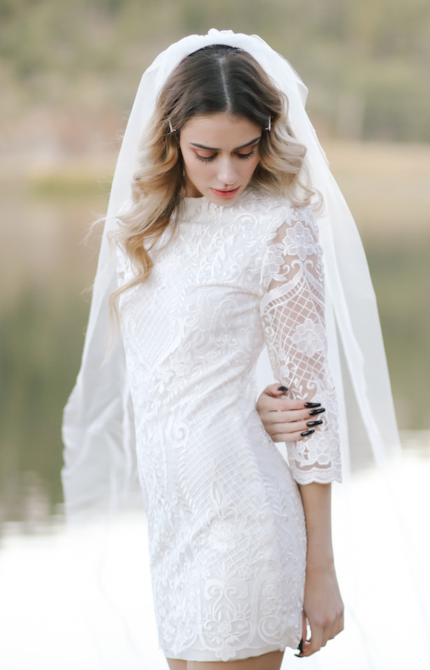 Short wedding dress with long sleeves - Photo: Tiffany Hudson Films