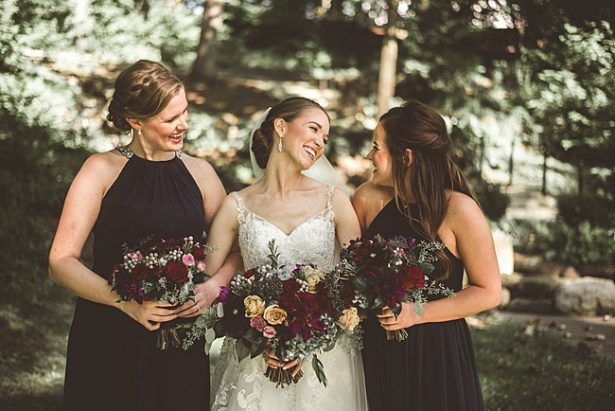 Sweet photo of bride with bridesmaids and burgundy wedding bouquets - Aileen Elizabeth Photography